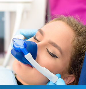 girl in dental chair receiving nitrous oxide