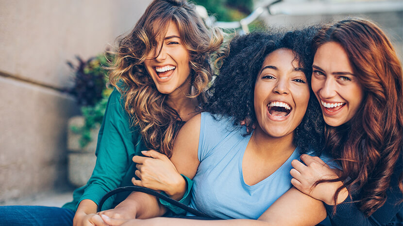 smiling women with whitened teeth
